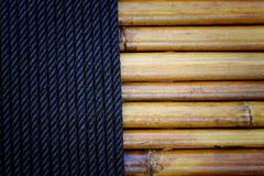 Old bamboo tied with blue rope Stock Image