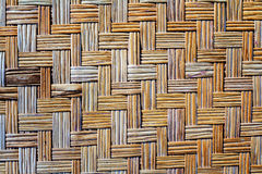 Old bamboo weave mat texture. And background Royalty Free Stock Photo