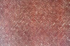 Old Bamboo weave wall. Old red paint Bamboo weave wall texture background Stock Photography