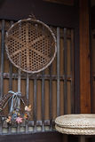 Old bamboo wicker basket on the wooden wall Stock Photography