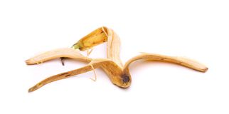 Old banana peel on white background Stock Images
