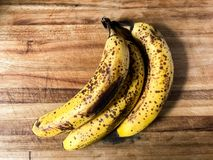 Old banana on a wood cutting board. Top view of old Royalty Free Stock Image