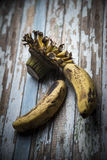 Old banana on a wooden table Royalty Free Stock Photography