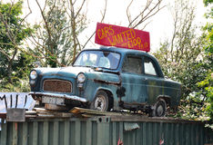 Old banger. Old Ford Anglia used as advertisement for scrap car business Stock Photography