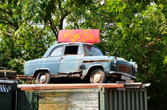 Old Banger. Old Ford Anglia used as advertisement for scrap car business Stock Photos