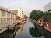 Old Bangkok canal and colonial buildings beside stock images