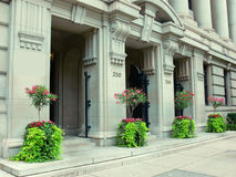 Old bank building. An old historic bank building in excelled conditions with four flowerpot Stock Photos
