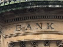 The old bank sign in UK. The old bank sign above entrance in UK / England / Europe stock photography