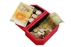 Old banknotes and coins in wooden casket. Isolated on white Royalty Free Stock Image