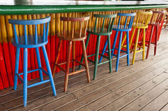 Old Bar Stools at a Tropical Pub Royalty Free Stock Images