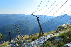 Old barb wired borderline on the mountain height Stock Image