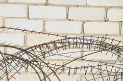 Old barbed wire against wall of the house Royalty Free Stock Photos