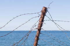 Old barbed wire fence and rusty post Royalty Free Stock Photo