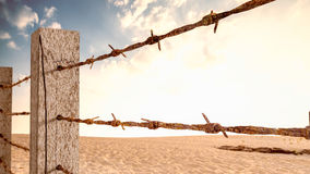 Old barbed wire mounted on wooden poles 3d render. It`s like a barrier to work or travel Stock Photo