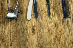 Old barber shop tools top. Vintage barber shop tools on old wooden background tools l Royalty Free Stock Images