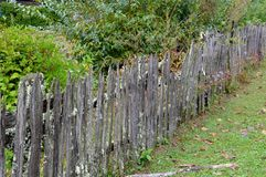 Old Bare Wood Picket Fence in the Country. Old wooden picket fence on an old farm in the country Stock Image