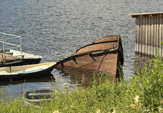 Old barge. Island Valaam. Monastery Bay. The old barge sunk near the shore Stock Photography