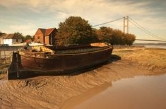 Old barge on mud bank. Royalty Free Stock Image