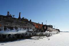 Old barge. River rusty used ark old water metal winter stock image