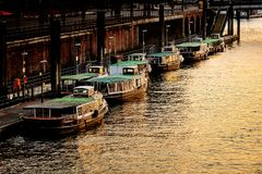 Old barges in the port of Hamburg. Dusk stock images