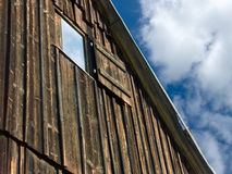 Old Barn. With blue sky reflecting in window Stock Photography
