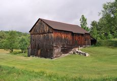 Old Barn. Sitting in a field in the Adirondacks royalty free stock photo