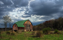 Old Barn. A rustic old barn under stormy skies Stock Photography