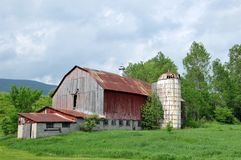 Old Barn. Old red, metal roofed barn and silo on a Vermont roadside stock images
