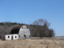 Old Barn. An old barn with an attached rundown shed on a very clear blue sky day Royalty Free Stock Image