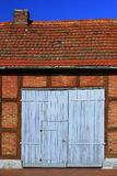 Old barn. Decorative old barn with a blue gate on the island of Usedom, Mecklenburg-Western Pomerania, Germany Stock Photo