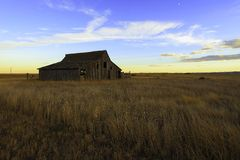 Old barn. An old house in sturgis south dakota at sunset look amazing with the grass on foreground Royalty Free Stock Photos
