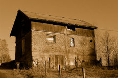 Old Barn. A sepia image of an old barn, done in a grainy, oldish style. RAW file is in colour, shot at ISO 1600 for the grainy look Stock Photo