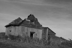 Old barn. An old barn falling down in black and white royalty free stock photography