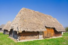 Old barn. Old houses with roof of thatch Stock Images