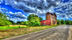 Old barn along a dirt road HDR Royalty Free Stock Photography