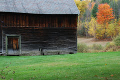 Old Barn in Autumn. Old barn on grassy field in autumn Stock Image