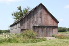 Old barn. Beautiful old weathered barn, closed up, with manicured lawn in front Royalty Free Stock Photos