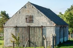 Wooden rolling door as a barn door on an old shed royalty free stock photo