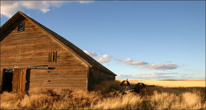 Old Barn Big sky. An old barn falling apart under a beautiful blue sky royalty free stock image