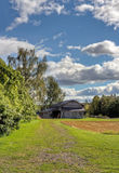 Old barn with blue sky and clouds Royalty Free Stock Photography