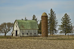Old Barn and Brick Silo Stock Photography