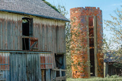 Old Barn and Brick Silo Royalty Free Stock Image