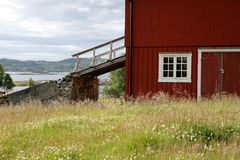 Old barn with barn bridge in a Norwegian highland royalty free stock images