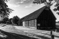 Old barn bw. Old barn by the road in skane Royalty Free Stock Images