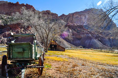 Old Barn and carriage in the Capitol Reef National Park, Utah. Old barn and wooden cart in Capitol Reef National Park Royalty Free Stock Image