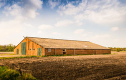 Old barn with a corrugated roof Royalty Free Stock Photography