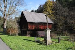 Old barn and cross in Bohemian Switzerland. With cross monument Stock Image