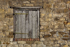 Old barn door. Architectural background and texture of a weathered timber door set in an ancient stone barn wall stock images