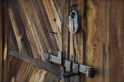 Old Barn Door with Metal Lock Royalty Free Stock Photos
