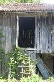 Old Barn Door. Old barn with open door Stock Photo